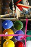 Colorful paint bucket and paint brushes stock photo