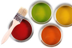 Colorful paint buckets with paintbrush Royalty Free Stock Images