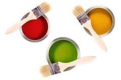 Colorful paint cans with brushes Royalty Free Stock Images
