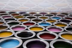 Colorful paint cans set. Full Buckets of rainbow colored oil paint royalty free stock photos
