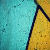 Colorful paint on concreat surface - toned filter. Royalty Free Stock Photos