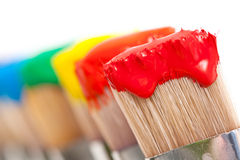 Colorful Paint On Brushes Stock Photo