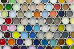Colorful paint sample pots. An arrangement of paint cans in bold and pastel colours Stock Images