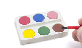 Colorful Paint set with hand and brush Royalty Free Stock Photography
