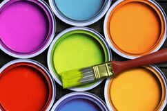Colorful paint. Seven colorful paint with a brush royalty free stock photography