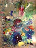 Colorful paint spilled and drip into sink. Art room sink with paint splatter Royalty Free Stock Photo