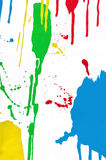 Colorful paint splash. On the white background Royalty Free Stock Images