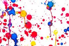 Colorful paint splashes isolated on white. Closeup background photo texture Stock Image