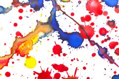 Colorful paint splashes over white paper. Closeup background photo texture Stock Photo