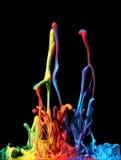 Colorful paint splashing Stock Image
