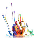 Colorful paint splashing. Isolated on white stock photography