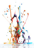 Colorful paint splashing. Isolated on white stock photos