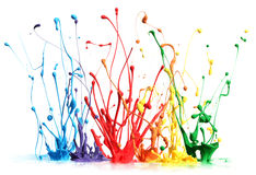 Colorful paint splashing. On white stock photos