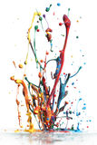 Colorful paint splashing. On white stock image