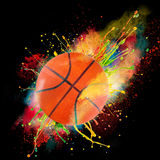 Colorful paint splashing. With basket ball isolated on black Stock Images