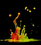 Colorful paint splashing Royalty Free Stock Images