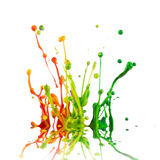 Colorful paint splashing. Isolated on white stock image