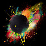 Colorful paint splashing. With squash ball isolated on black stock photo