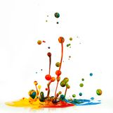 Colorful paint splashing. On white background royalty free stock photos