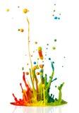 Colorful paint splashing Stock Images
