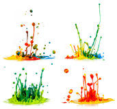 Colorful paint splashing. On white background stock photos