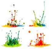 Colorful paint splashing Stock Photos