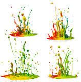 Colorful paint splashing. On white background stock photography