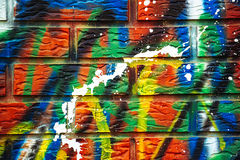 Colorful paint sprayed brick wall Stock Photo