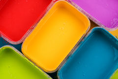 Colorful paint trays Stock Photo