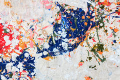Colorful paint on wood background. Royalty Free Stock Photos