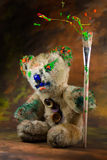 Colorful paintbrush in hand of a wizard teddy bear Stock Photography