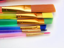 Colorful Paintbrushes. A rainbow colored group of paintbrushes ready to be picked up and used to create artwork Stock Images