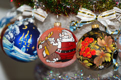 Colorful painted Christmas ball in a row, selective focus. Creatively painted chrismas balls with shiny background royalty free illustration
