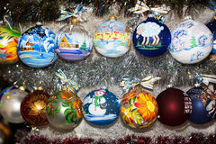 Colorful painted Christmas ball in a row, selective focus. Creatively painted chrismas balls with shiny background vector illustration