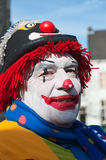 Colorful painted clown with a hat. Stock Photography