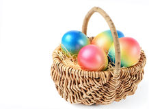 Colorful painted easter eggs in basket Royalty Free Stock Photos