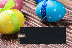 Colorful painted easter eggs and black label labeling Royalty Free Stock Photo