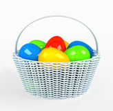 Colorful painted easter eggs in brown basket Stock Photos