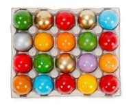 Colorful painted Easter eggs in cardboard storage rack Stock Image