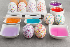 Decoration Easter eggs. Colorful painted Easter eggs, colored water and brush Stock Photo