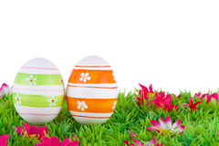 Colorful painted easter eggs located on a meadow with flowers Stock Image