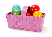 Easter eggs in purple basket Royalty Free Stock Photo
