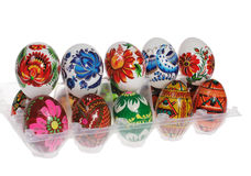 Colorful painted Easter eggs in a red plastic tray. On a white background royalty free stock images