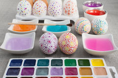 Decoration Easter eggs. Colorful Painted Easter eggs, watercolors, colored water and brush Royalty Free Stock Photo