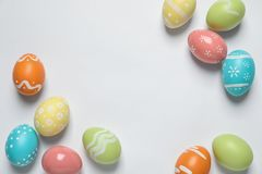Colorful painted Easter eggs on white background. Top view stock images