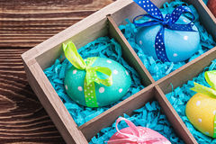 Colorful painted easter eggs in a wooden box Stock Image
