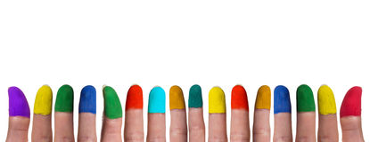 Colorful painted fingers in on line. Colorful painted fingers in one line on front of white background stock photography