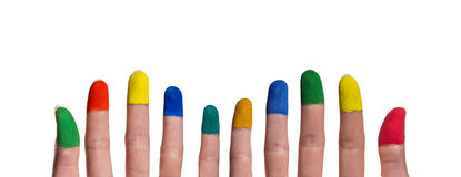 Colorful painted fingertips of woman's hand. Colorful painted fingertips in front of white background stock images