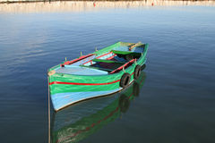 Colorful painted fishing boat Stock Image