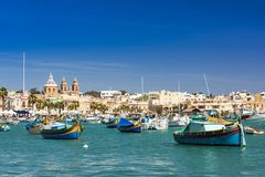 Colorful painted fishing boats in Marsaxlokk,Malta.  Stock Photo